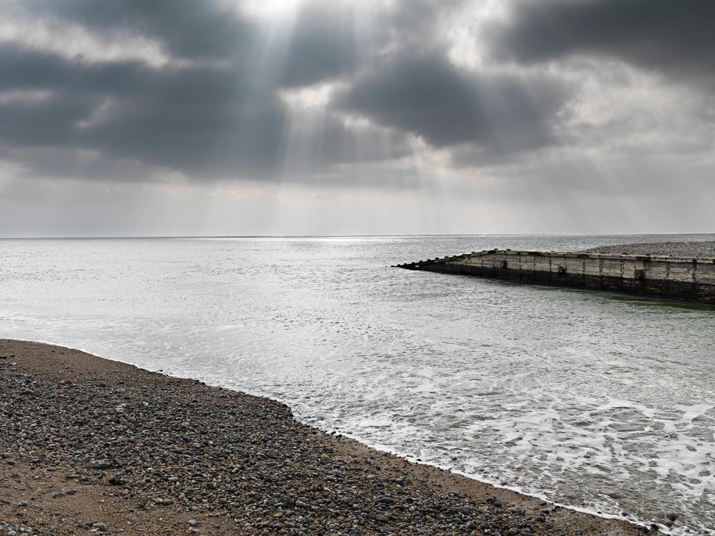 sun clouds sea